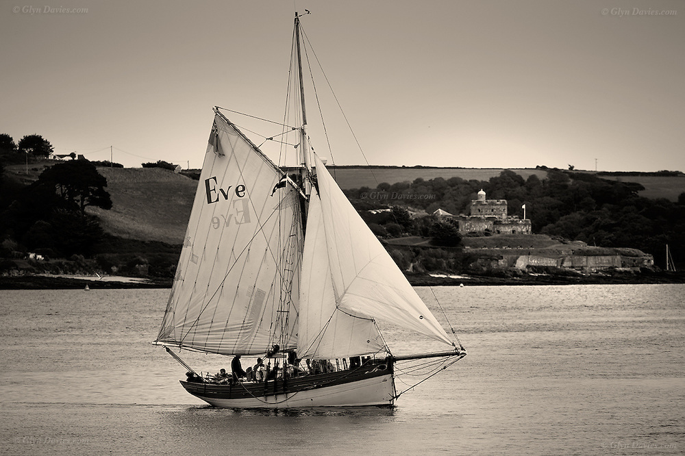 This is a pilot cutter which although looks old, was actually only launched in 1997. These classic gaff rigged boats are an instant visual reminder of the beauty of maritime history, as much as the hardship. In the background squats King Henry VIII's St Mawes Castle (1540 AD) so we have layers of history in this shot
