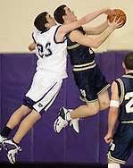 Monroe-Woodbury's Greg Sullivan, left, tries to block a shot by Pine Bush's Shane Merone during a game in Central Valley on Jan. 6, 2006..
