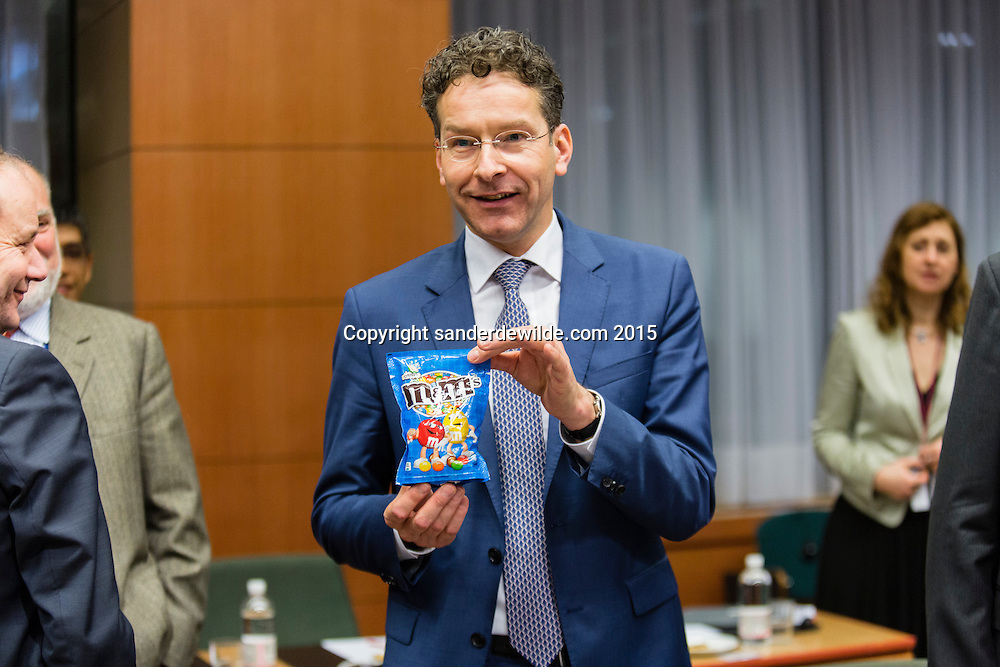 Brussels 20 february 2015 At the beginning of a crucial Eurogroup meeting J. Dijsselbloem shows a blue bag of m&M's and tells the press it was a present of mrs. Lagarde