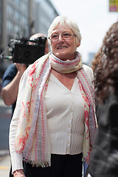 © licensed to London News Pictures. London, UK 25/04/2013. Doreen Jones, who lost her son Richard, joins other families of the 96 football fans who lost their lives in the Hillsborough disaster at the Family Division of the High Court in London on Thursday, 25 April 2013. A hearing to decide the date and location of a new inquest into the 96 people who died in the Hillsborough disaster has begun in London. Photo credit: Tolga Akmen/LNP