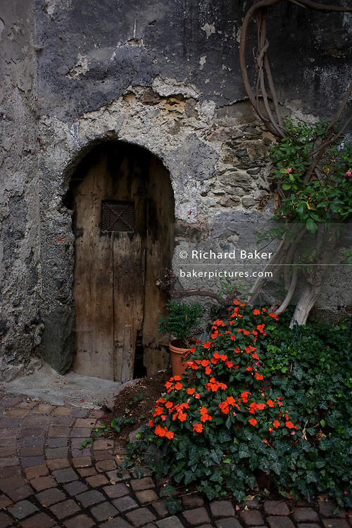 Typical wooden doorways in a backstreet courtyard of the modern town of Klausen-Chiusa in south Tyrol, north Italy.