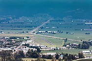 View of Chilliwack Airport (YCW),  Highway 1 (Trans Canada Highway), and the surrounding farmland.  Photographed from the Hillkeep Regional Park viewing platform in Chilliwack, British Columbia, Canada.