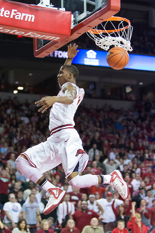 FAYETTEVILLE, AR - JANUARY 23:  BJ Young #11 of the Arkansas Razorbacks goes up for a dunk against the Mississippi State Bulldogs at Bud Walton Arena on January 23, 2013 in Fayetteville, Arkansas. The Razorbacks defeated the Bulldogs 96-70.  (Photo by Wesley Hitt/Getty Images) *** Local Caption *** BJ Young