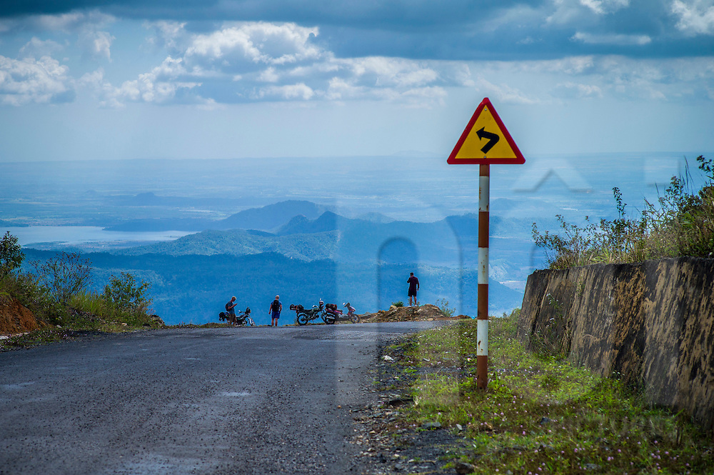A group of riders stop along the QL28 between Da Lat and Mui Ne, Vietnam, Southeast Asia