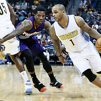 16 November 2016: Denver Nuggets guard Jameer Nelson (1) drives past Phoenix Suns guard Eric Bledsoe (2) on a screen set by Denver Nuggets forward Kenneth Faried (35) during the Denver Nuggets 120-104 victory over the Phoenix Suns, at the Pepsi Center, Denver, Colorado, USA.