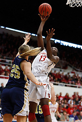 March 19, 2011; Stanford, CA, USA; Stanford Cardinal forward Chiney Ogwumike (13) shoots over UC Davis Aggies guard/forward Kasey Riecks (25) during the first half of the first round of the 2011 NCAA women's basketball tournament at Maples Pavilion.