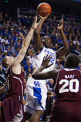 UK forward Alex Poythress, center, shoots over Mississippi State forward Colin Borchert, left, contests the shot. The University of Kentucky Men's Basketball team hosted Mississippi State , Wednesday, Feb. 27, 2013 at Rupp Arena in Lexington .