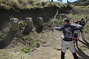 Bill Dragoo (left), Val (center) and Gary Kepple (right) shooting bows & arrows during pit competition at 2010 Rawhyde Adventure Rider Challenge