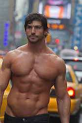 very hot man without a shirt walking in Times Square, New York City