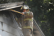 Lafayette County firemen put out a house fire on County Road 196 near Oxford, Miss. on Thursday, September 2, 2010.