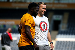Andi Weimann of Bristol City arrives for the Sky Bet Championship fixture against Hull City and talks to Nouha Dicko of Hull City - Mandatory by-line: Robbie Stephenson/JMP - 24/08/2019 - FOOTBALL - KCOM Stadium - Hull, England - Hull City v Bristol City - Sky Bet Championship