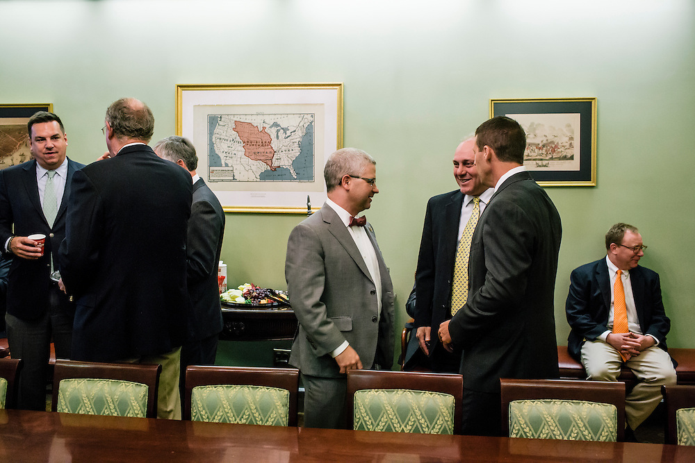 U.S. Rep. Patrick McHenry (R-N.C.), the chief deputy whip of House Republicans, talks with fellow republicans, including Majority Whip Steve Scalise, right, at a weekly deputy whip meeting at the U.S. Capitol on April 23, 2015. McHenry is considered one of the fastest-rising stars of House Republicans.