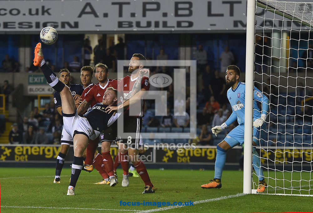 Millwall&rsquo;s Aiden O'Brien tries an acrobatic overhead kick but his effort drifts just wide during the Sky Bet Championship match at The Den, London<br /> Picture by Daniel Hambury/Focus Images Ltd 07813022858<br /> 15/08/2017