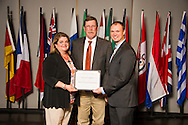 Lawton native Jonathan Lehman (right), a plant and soil sciences major, receives an Oklahoma State University Oklahoma Soybean Board Scholarship from Rick and Ginger Reimer (left) at the university's recent College of Agricultural Sciences and Natural Resources Scholarships and Awards Banquet. The scholarship is part of more than $1.4 million in scholarships and awards presented to CASNR students for the 2016-2017 academic year. (Photo by Todd Johnson)
