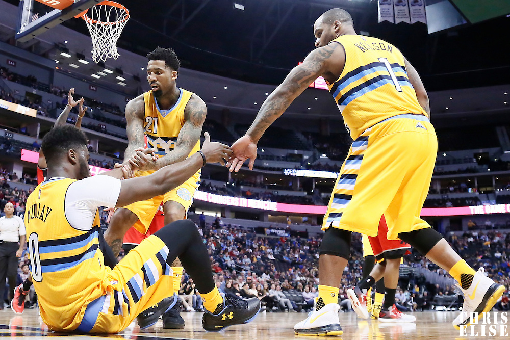18 November 2016: Denver Nuggets guard Emmanuel Mudiay (0) is helped by Denver Nuggets forward Wilson Chandler (21) and Denver Nuggets guard Jameer Nelson (1) during the Toronto Raptors 113-111 OT victory over the Denver Nuggets, at the Pepsi Center, Denver, Colorado, USA.