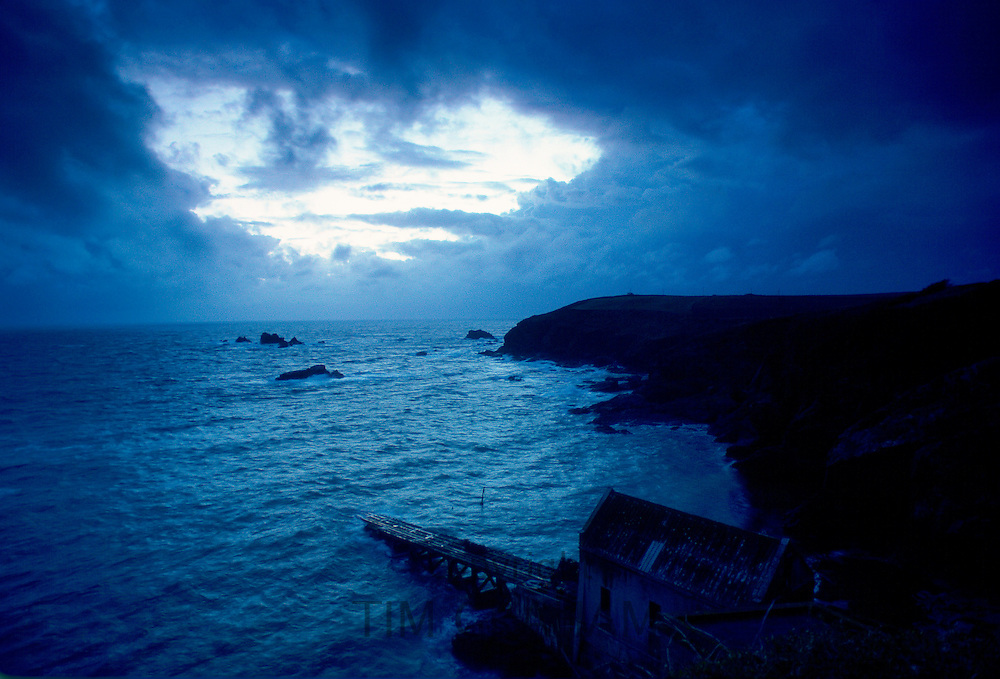 Dusk at Lizard Point in Cornwall, South West England. In the foreground is the old lifeboat station.