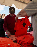 Tina Toutain hands out tshirts for the upcoming Pumpkin Fest during Lucky Jr's birthday party at Sanborn's Auto Repair.  (Karen Bobotas/for the Laconia Daily Sun)