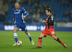 Bournemouth's Brett Pitman passes the ball past the path of Cardiff City's Matthew Connolly - Photo mandatory by-line: Alex James/JMP - Mobile: 07966 386802 - 17/03/2015 - SPORT - Football - Cardiff - Cardiff City Stadium - Cardiff City v AFC Bournemouth - Sky Bet Championship