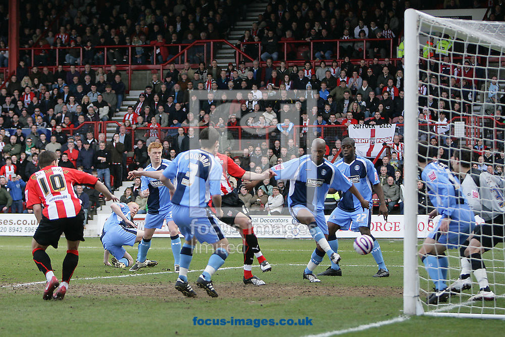 London - Saturday, March 14th, 2009: Jordan Rhodes (C) of Brentford scores his side's first goal during the Coca Cola League Two match at Griffin Park, London. (Pic by Mark Chapman/Focus Images)
