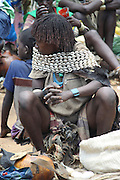 Ethiopia. Omo Valley, Bana Tribe woman in shells and leather