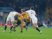 Matt Giteau  is tackled high during the Rugby World Cup Pool A match between England and Australia at Twickenham, Richmond, United Kingdom on 3 October 2015. Photo by Ian Muir.during the Rugby World Cup Pool A match between England and Australia at Twickenham, Richmond, United Kingdom on 3 October 2015. Photo by Ian Muir.