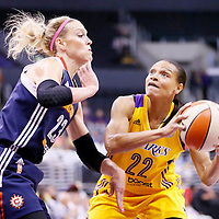 03 August 2014: Los Angeles Sparks guard/forward Armintie Herrington (22) drives past Connecticut Sun guard/forward Katie Douglas (23) during the Los Angeles Sparks 70-69 victory over the Connecticut Sun, at the Staples Center, Los Angeles, California, USA.
