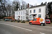 Nederland, Vaals, 8-2-2014een postbode van Postnl brengt met zijn bestelauto de post rond in het buitengebied van Zuid Limburg.Foto: Flip Franssen/Hollandse Hoogte