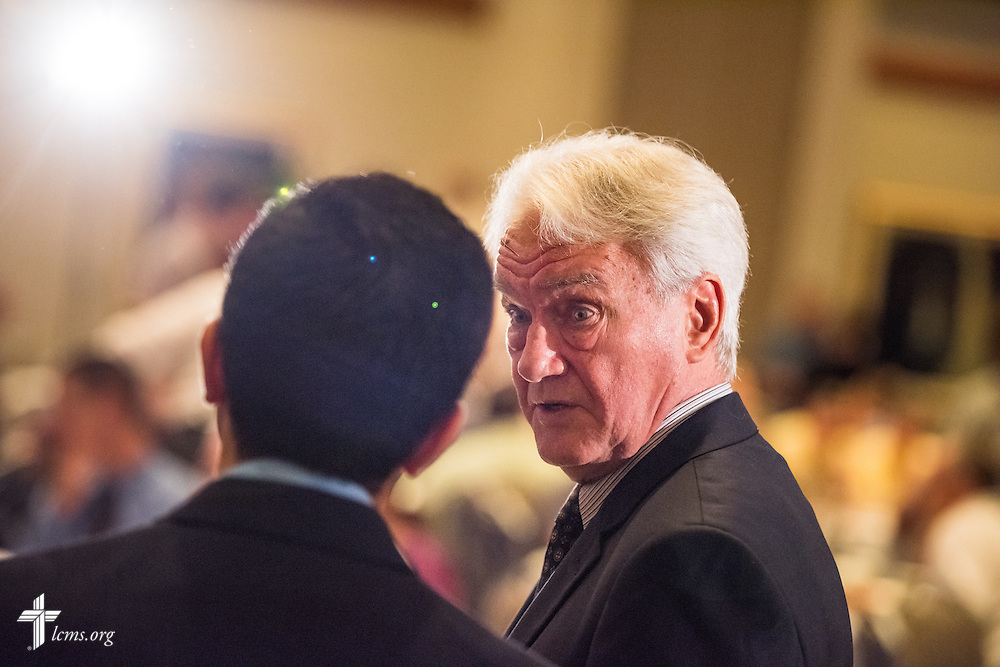 "The Rev. Dr. John W. Kleinig, professor emeritus at Luther College, Adelaide, SA, Australia, chats with fellow speaker Sherif Girgis during the DOXOLOGY event, ""Finding Our Voice,"" on Wednesday, August 12, 2015, at Saint Louis University in Midtown St. Louis. LCMS Communications/Erik M. Lunsford"