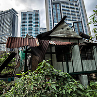 An abandoned house against the modern skycrapers in Kampung Baru, Kuala Lumpur, Malaysia, 18 April 2017.