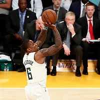 30 March 2018: Milwaukee Bucks guard Eric Bledsoe (6) takes a jump shot during the Milwaukee Bucks 124-122 victory over the LA Lakers, at the Staples Center, Los Angeles, California, USA.