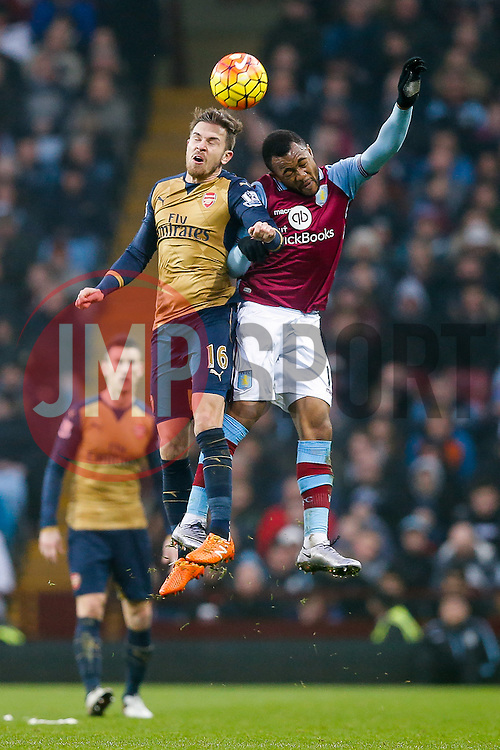 Aaron Ramsey of Arsenal and Jordan Ayew of Aston Villa compete in the air - Mandatory byline: Rogan Thomson/JMP - 13/12/2015 - FOOTBALL - Villa Park Stadium - Birmingham, England - Aston Villa v Arsenal - Barclays Premier League.