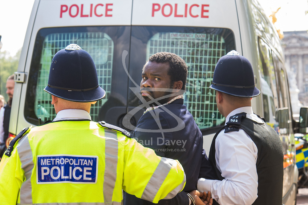 St James, London, May 12th 2016. Biafra protesters are arrested after attempting to breach police lines outside Lancaster House where the corruption conference attended by many world leaders is taking place amid heavy security