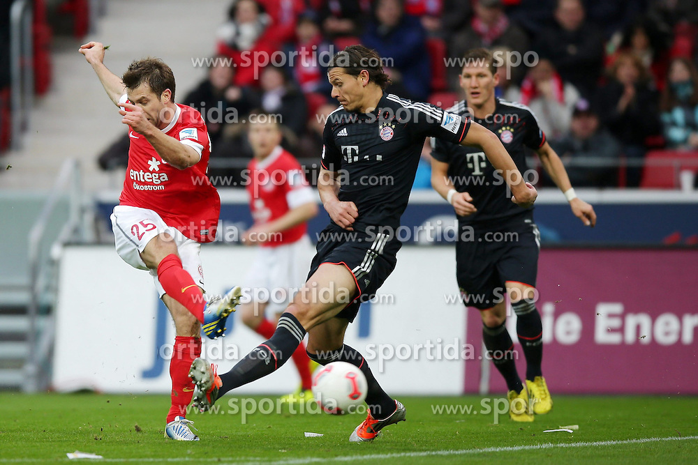 02.02.2013, Coface Arena, Mainz, GER, 1. FBL, 1. FSV Mainz 05 vs FC Bayern Muenchen, 20. Runde, im Bild Andreas IVANSCHITZ (FSV Mainz 05 - 25) - Daniel VAN BUYTEN (FC Bayern Muenchen) - hinten Bastian SCHWEINSTEIGER (FC Bayern Muenchen - 31) // during the German Bundesliga 20th round match between 1. FSV Mainz 05 and FC Bayern Munich at the Coface Arena, Mainz, Germany on 2013/02/02. EXPA Pictures © 2013, PhotoCredit: EXPA/ Eibner/ Gerry Schmit..***** ATTENTION - OUT OF GER *****