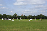 Men playing cricket in Regent's Park, one of London's Royal Parks