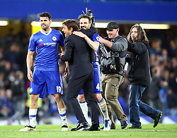 May 8, 2017 - Chelsea, Greater London, United Kingdom - Chelsea manager Antonio Conte  celebrates with Chelsea's Cesc Fabregas.during Premier League match between Chelsea and Middlesbrough at Stamford Bridge, London, England on 08 May 2017. (Credit Image: © Kieran Galvin/NurPhoto via ZUMA Press)