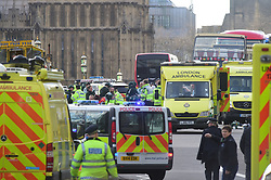 Emergency personnel on Westminster Bridge, close to the Palace of Westminster, London, after at least two people have died after a knifeman brought terror to the heart of Westminster, mowing down pedestrians then stabbing a policeman before he was shot by armed officers.