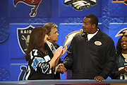 Show host Pat Sajak and a contestant with Carolina Panthers defensive tackle Kris Jenkins at NFL Players Week on Wheel of Fortune on 11/04/2003. ©Paul Anthony Spinelli