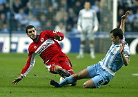 Photo: Chris Ratcliffe.<br />Coventry City v Middlesbrough. The FA Cup. 28/01/2006.<br />Stuart Parnaby (L) of Boro tackles Michael Doyle.