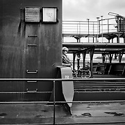 MIRAFLORES LOCKS - PANAMA CANAL<br /> Photography by Aaron Sosa<br /> Panama City, Panama 2012<br /> (Copyright © Aaron Sosa)<br /> <br /> Employee of a boat that crosses the Panama Canal<br /> <br /> The Panama Canal is an 77.1-kilometre (48 mi) ship canal in Panama that connects the Atlantic Ocean (via the Caribbean Sea) to the Pacific Ocean. The canal cuts across the Isthmus of Panama and is a key conduit for international maritime trade. There are locks at each end to lift ships up to Lake Gatun (26m (85ft) above sea-level) which was used to reduce the amount of work required for a sea-level connection. The current locks are 33.5m (110ft) wide although new larger ones are proposed.<br /> <br /> Work on the canal, which began in 1881, was completed in 1914, making it no longer necessary for ships to sail the lengthy Cape Horn route around the southernmost tip of South America (via the Drake Passage) or to navigate the dangerous waters of the Strait of Magellan. One of the largest and most difficult engineering projects ever undertaken, the Panama Canal shortcut made it possible for ships to travel between the Atlantic and Pacific Oceans in half the time previously required. The shorter, faster, safer route to the U.S. West Coast and to nations in and along the Pacific Ocean allowed those places to become more integrated with the world economy.