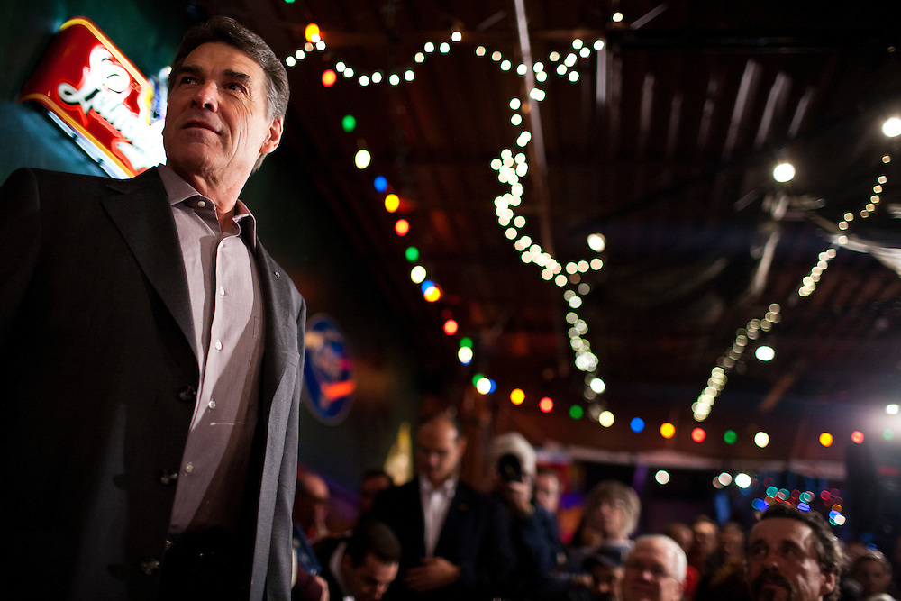 Republican presidential candidate Rick Perry arrives to speak at the Fainting Goat on Friday, December 30, 2011 in Waverly, IA.