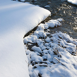 The Ottauquechee River in winter in Quechee, Vermont.