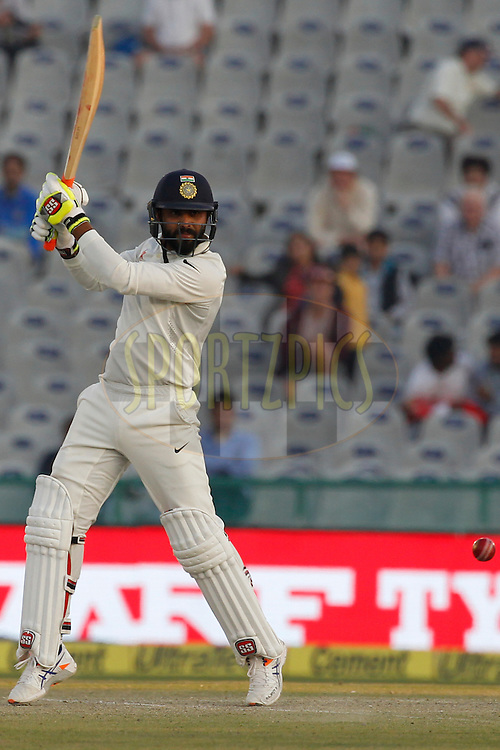 Ravindra Jadeja of India plays a shot during day 2 of the third test match between India and England held at the Punjab Cricket Association IS Bindra Stadium, Mohali on the 27th November 2016.<br /> <br /> Photo by: Deepak Malik/ BCCI/ SPORTZPICS