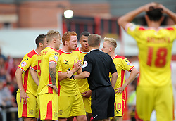 MK Dons players argue with the referee after Scott Mathieson gives a penalty - Photo mandatory by-line: Dougie Allward/JMP - Mobile: 07966 386802 - 27/09/2014 - SPORT - Football - Bristol - Ashton Gate - Bristol City v MK Dons - Sky Bet League One