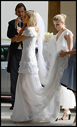 Cara Delevingne holds her sisters poppy dress as they arrive at  Poppy's wedding to James Cook at St.Paul's Church in Knightsbridge, London,  Friday, 16th May 2014. Picture by Andrew / i-Images