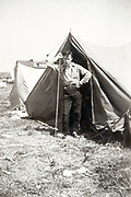 man psing by tent ca 1940s