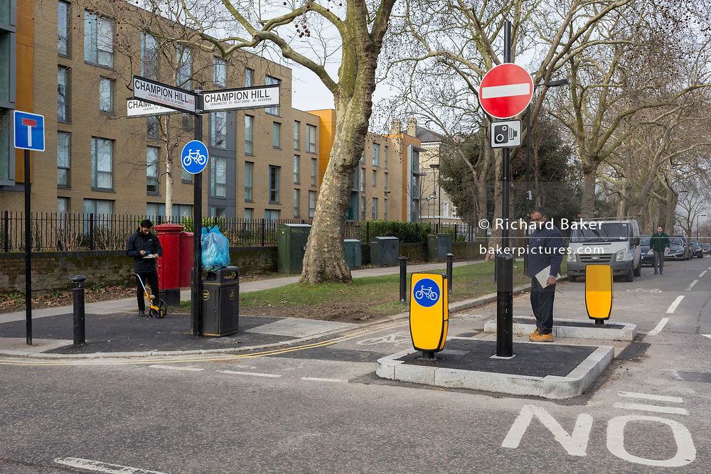 Southwark Council road engineers inspect a new junction layout at Champion Hill, on 13th February 2019, in London, England.