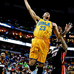 Mar 29, 2013; New Orleans, LA, USA; New Orleans Hornets power forward Anthony Davis (23) attempts a dunk over Miami Heat power forward Udonis Haslem (40) during the first quarter of a game at the New Orleans Arena. Mandatory Credit: Derick E. Hingle-USA TODAY Sports