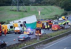 © Licensed to London News Pictures.  16/09/2017; Thornbury, South Gloucestershire, UK. Fatal accident on the M5 motorway. At least 4 people have died.  At just before 2.30pm, a lorry travelling southbound went through the central reservation and was in collision with at least two other vehicles in the northbound carriageway. Four people are believed to have died and a number of others have been taken to hospitals in the Bristol area. South Western Ambulance Service have been assisting casualties at the scene and sent 13 resources to the scene, including operations officers, two critical care paramedic teams, four hazardous area response teams (HART) and five double-crewed ambulances. Avon Fire & Rescue Service sent six appliances and its Major Rescue Tender to the scene. Picture credit : Simon Chapman/LNP