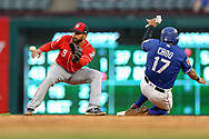 March 26, 2018 - Arlington, TX, U.S. - ARLINGTON, TX - MARCH 26: Texas Rangers designated hitter Shin-Soo Choo (17) is tagged out by Cincinnati Reds shortstop Jose Peraza (9) during the exhibition game between the Cincinnati Reds and Texas Rangers on March 26, 2018 at Globe Life Park in Arlington, TX. (Photo by Andrew Dieb/Icon Sportswire) (Credit Image: © Andrew Dieb/Icon SMI via ZUMA Press)