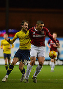 Northampton Town Defender Rodney McDonald and Oxford United Forward Danny Hylton during the Sky Bet League 2 match between Oxford United and Northampton Town at the Kassam Stadium, Oxford, England on 16 February 2016. Photo by Adam Rivers.